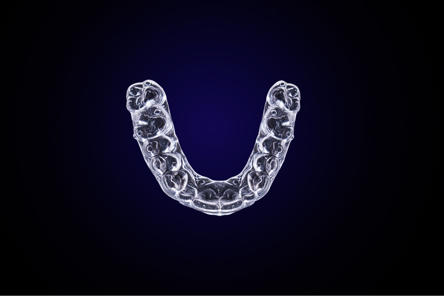 Aerial view of clear aligners tray against blue background in Lansdowne, VA