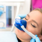 Woman relaxes at the dentist while receiving nitrous oxide in Lansdowne, VA